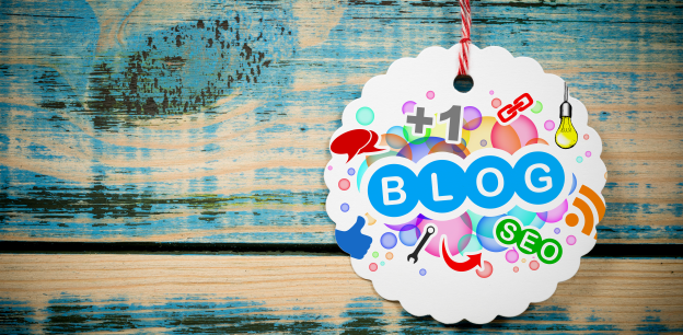 White Tag with the Blog & SEO Written on it against a blue wooden background.